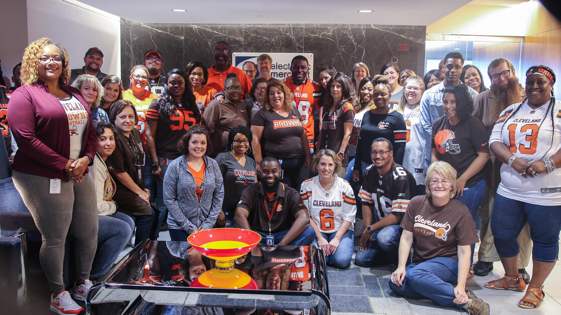 The EMS team poses with Cleveland Browns player TJ Carrie.