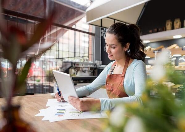 a-small-business-owner-looking-over-retained-customers