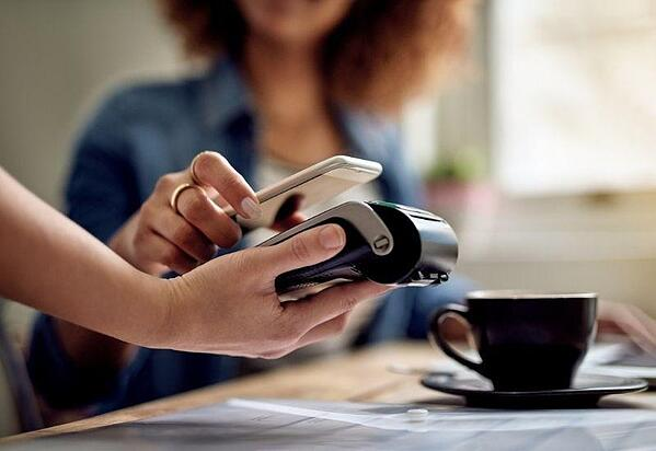 a-customer-using-mobile-payment-in-fayetteville-nc