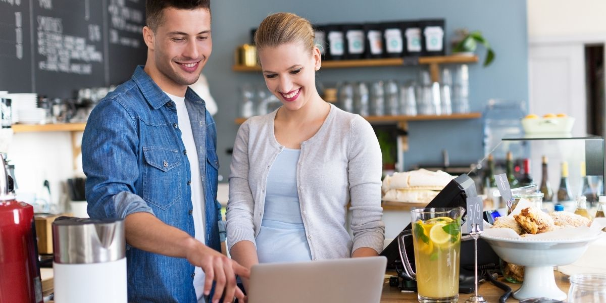 pos-dealer-in-portland-ct-showing-a-merchant-how-to-use-total-touch