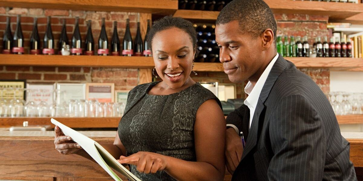 a-cash-register-dealer-showing-her-merchant-how-a-reliable-pos-will-help-his-business-in-eaton-co