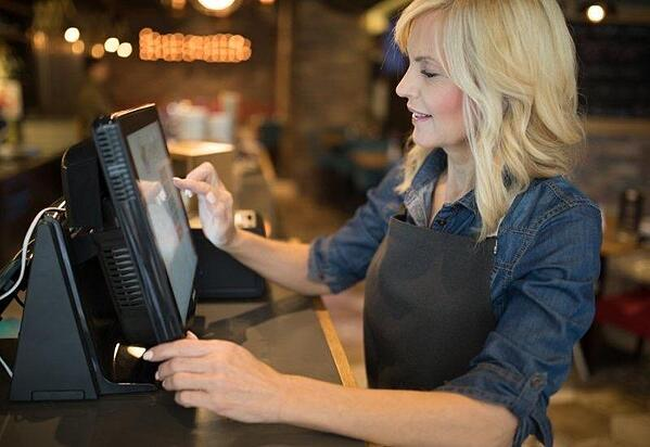 a-server-using-an-restaurant-point-of-sale-system-in-fayetteville