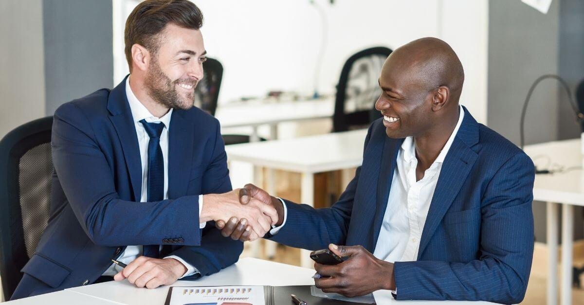 a-merchant-agent-in-new-cassel-closing-a-deal