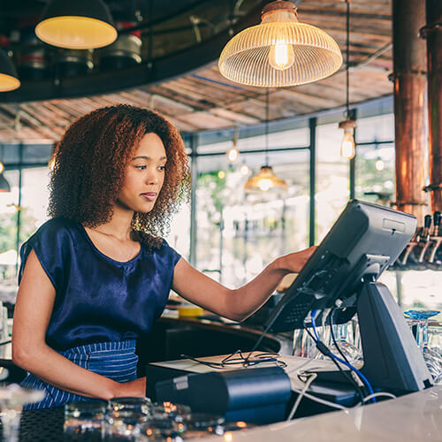 waitress-at-restaurant-processing-credit-card-payment