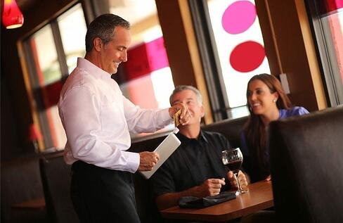 waiter utilizing pos total touch software